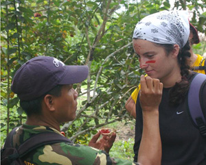 Student getting face painted with red dye