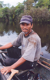 Man sitting in the front of a canoe