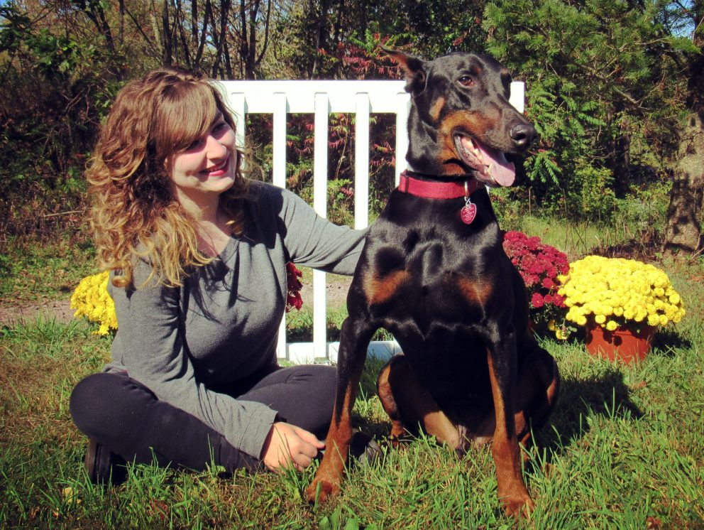 Sarah Isgate sitting next to a dog