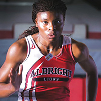 Albright track and field athlete running
