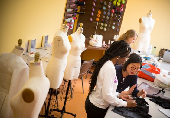 students and faculty work in Albright's fashion studio