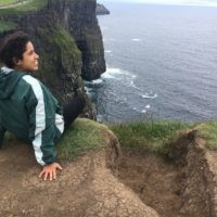 Destini Torres on a cliff in Ireland
