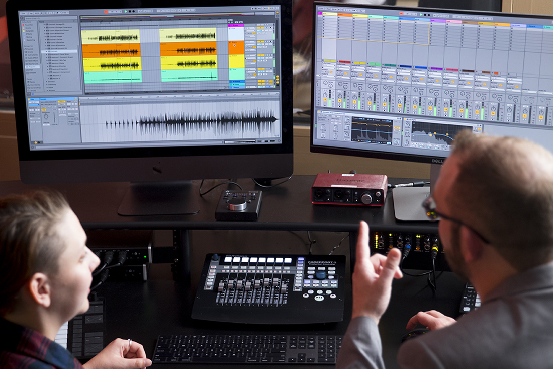 Student and professor working on a music production project