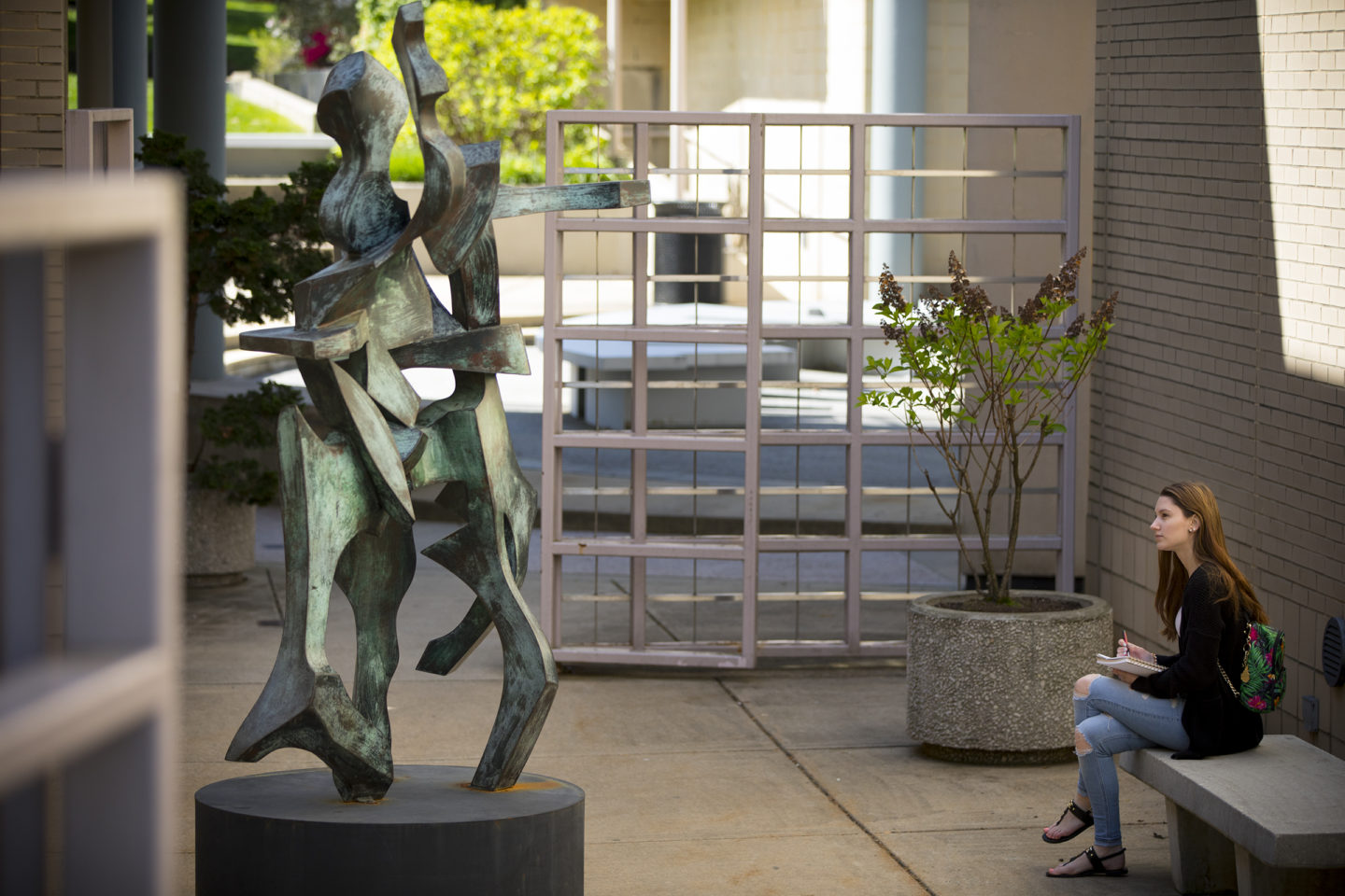 Student in sculpture garden