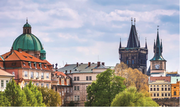 European buildings, cathedral towers and trees