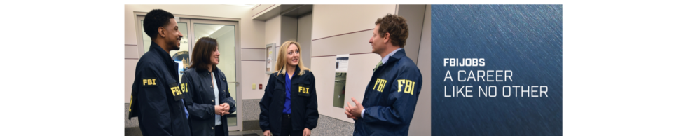 FBIJobs A Career Like No Other. Four FBI agents in a conference room speaking with one another.