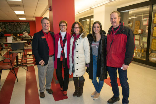 The president of Albright College standing with alumni and faculty