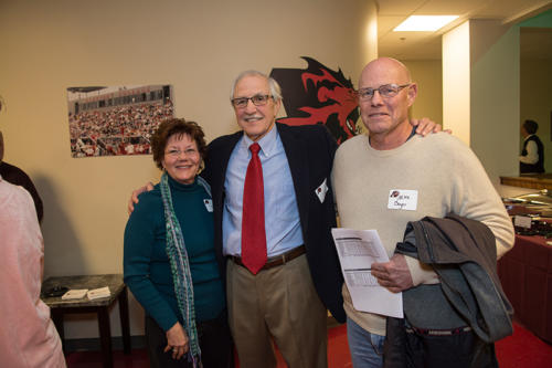 John Scholl smiling with alumni