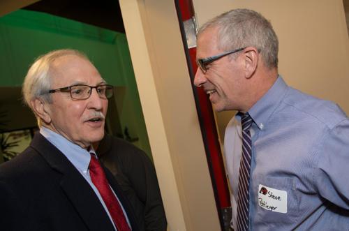 Alumni John Scholl talking to Alumni Steve Pottieger