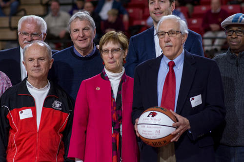 The president of Albright College next to John Scholl and other alumni