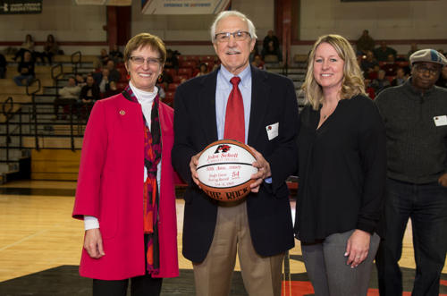 The president of Albright College with John Scholl and an alumni