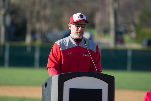 Man in an Albright Baseball jacket giving a speech at a podium
