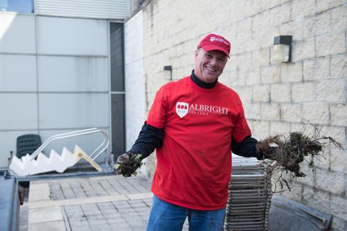A volunteer holding debris