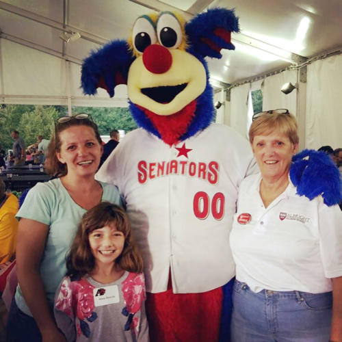 Faculty and family standing with the Senator's mascot