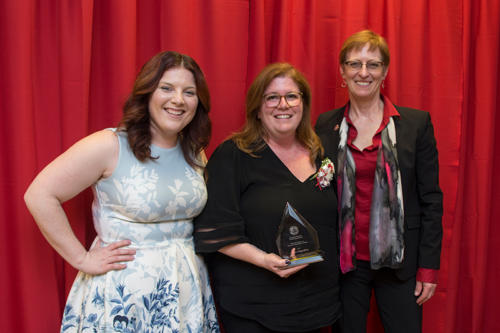 The president of Albright College with an award recipient