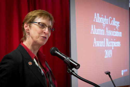 The President of Albright College presenting alumni awards