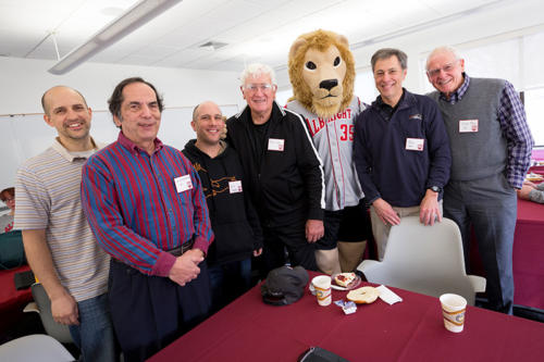 A group of alumni standing with the Albright College Mascot