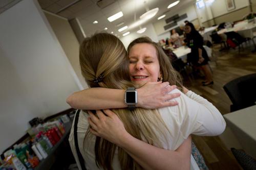 Two alumni hugging