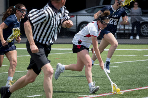 Albright womens lacrosse team running down the field