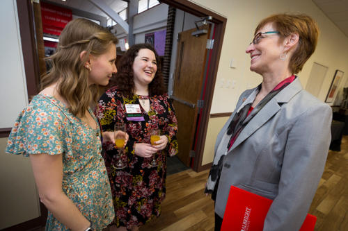 The president of Albright College talking to two alumni