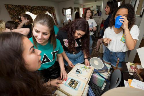 Alumni sorority sisters looking through old photo albums