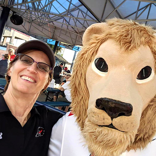 A selfie of the president of Albright College and the Albright Lion