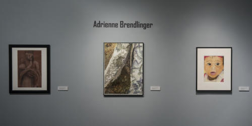 Adrienne Brendlinger's work displayed on the wall