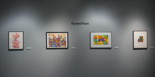 Raymond Reyes' work displayed on the wall